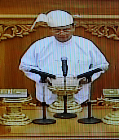An image taken off Myanmar's state-run MRTV shows newly-appointed president, former prime minister Thein Sein (C), during his swearing-in ceremony at the national parliament in the country's new capital Naypyidaw on March 30, 2011