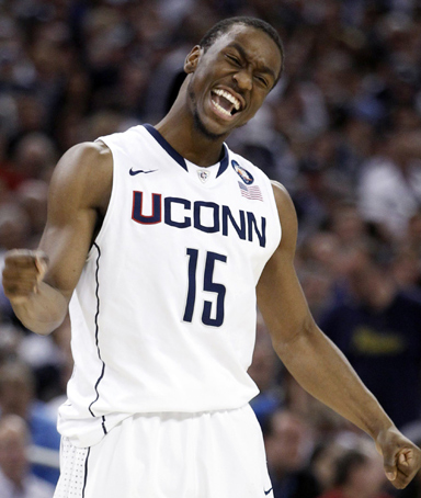 Connecticut Huskies guard Kemba Walker celebrates a basket against the Butler Bulldogs during their men's final NCAA Final Four College Championship basketball game in Houston, Texas, April 4, 2011.