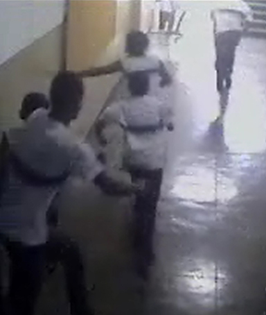 An image taken from a security camera video distributed by the Rio police shows students of the Tasso da Silveira school running from the classroom where a gunman opened fire on them, in the Realengo neighborhood of Rio de Janeiro April 7, 2011.