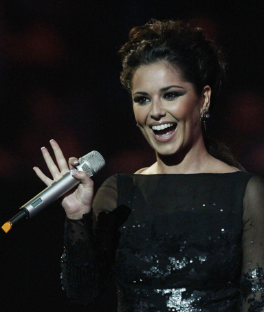 British singer Cheryl Cole arrives on stage to present Rihanna with