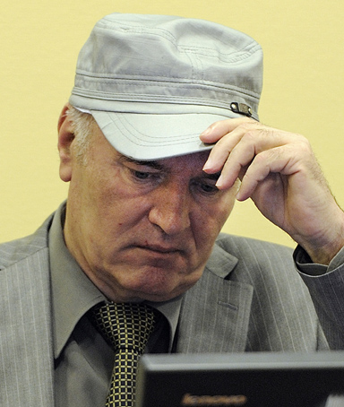 Former Bosnian Serb commander Ratko Mladic adjusts his hat as he appears in court at the International Criminal Tribunal for the former Yugoslavia (ICTY) in the Hague, June 3, 2011