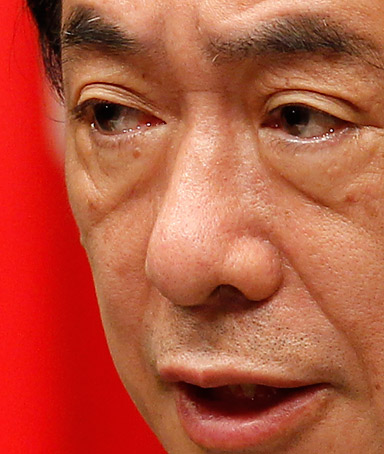 Japan's Prime Minister Naoto Kan makes a speech at a news conference in Tokyo May 18, 2011.