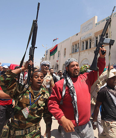 Rebel fighters attend the funeral of a colleague killed by forces loyal to Libyan leader Muammar Gaddafi, in Benghazi May 7, 2011.