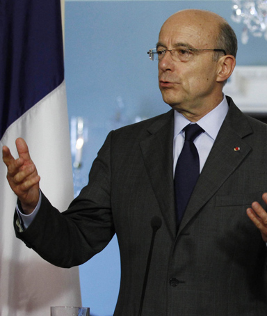 France's Foreign Minister Alain Juppe speaks at the U.S. Department of State in Washington, June 6, 2011