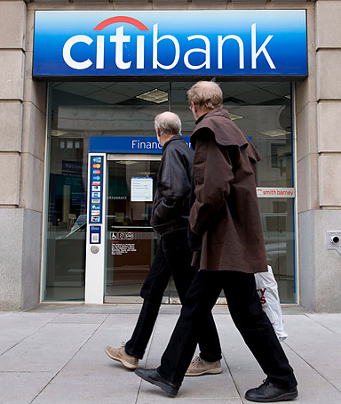 Pedestrians walk past a Citibank branch in downtown Washington, DC, USA.