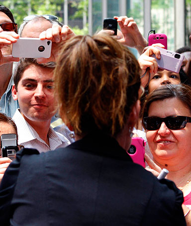 Sarah Palin is photographed as she greets people outside Fox News headquarters before boarding her