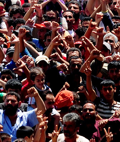 Syrian refugees gather for a protest against Syrian President Bashar al-Assad at the Turkish Red Crescent camp on June 20, 2011.