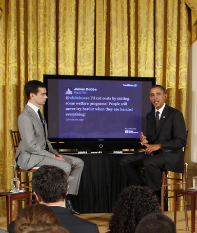 U.S. President Barack Obama talks to the audience next to Twitter co-founder Jack Dorsey (L) during his first ever Twitter Town Hall in the East Room at the White House in Washington, July 6, 2011
