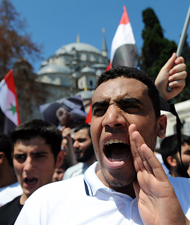 Protesters shout slogans against Syrian President Bashar al-Assad during a demonstration held after the Friday prayers on June 24, 2011, in Istanbul.