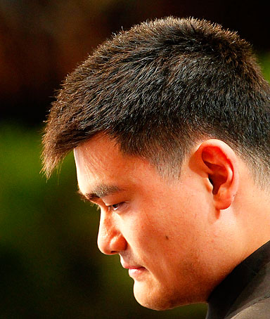 NBA star Yao Ming pauses after he announced his retirement during a press conference in Shanghai, China, Wednesday, July 20, 2011.