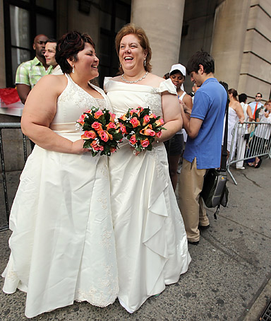 Barbara Tremblay (L) and Stacey Minondo wait on line to get married at the Brooklyn City Clerk's office on July 24, 2011 in New York City.
