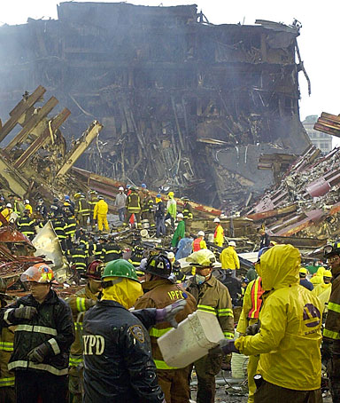 Firemen and rescue personnel work at the base of the World Trade Center 14 September 2001, in New York.
