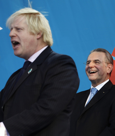 London Mayor Boris Johnson speaks, alongside the President of the International Olympic Committee Jacques Rogge, during a one year countdown to the London 2012 Olympic Games event in Trafalgar Square, July 27, 2011