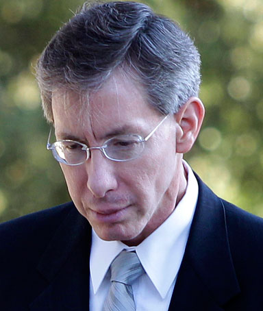 Polygamist religious leader Warren Jeffs, arrives at the Tom Green County Courthouse escorted by a law enforcement officer Wednesday, Aug. 3, 2011, in San Angelo, Texas.