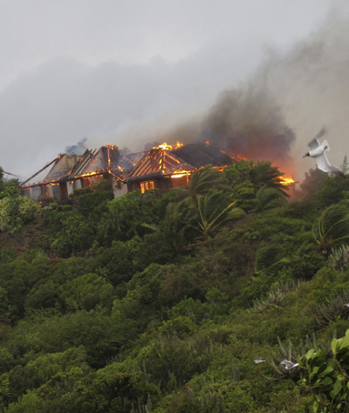 A fire sweeps through Richard Branson's Caribbean holiday retreat in this photograph taken and released August 22, 2011 by Virgin Management Ltd.