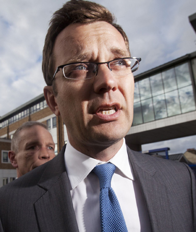Andy Coulson, the former spokesman for Britain's Prime Minister David Cameron, leaves a police station after being bailed in South London in this July 8, 2011 file photo