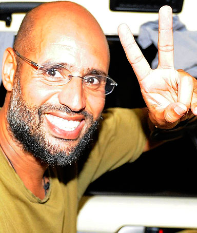 Saif al-Islam, the son of Libyan leader Muammar Gaddafi, gestures as he talks to reporters in Tripoli August 23, 2011.