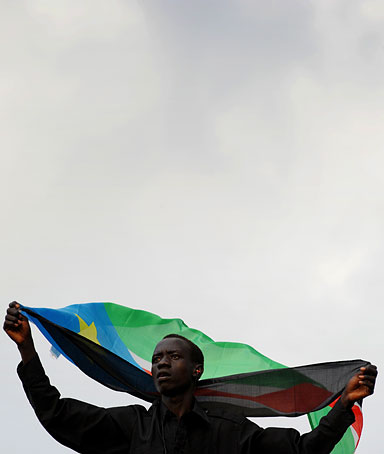 A South Sudanese man waves his country's flag in Juba on July 10, 2011.
