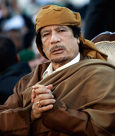 Libyan Leader Muammar Gaddafi attends a ceremony in Tripoli on February 13, 2011.