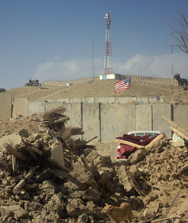 Debris are seen out side of the gates of a Combat Outpost in Sayed Abad, Wardak province of Afghanistan on Sunday, Sept. 11, 2011.