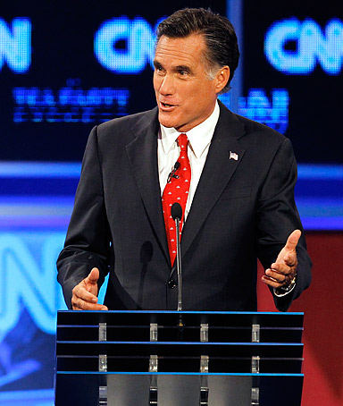 Former Massachusetts Gov. Mitt Romney gestures during a Republican presidential debate Monday, Sept. 12, 2011, in Tampa, Fla.