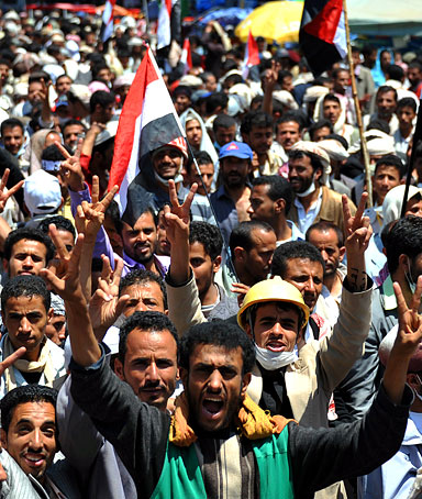 Yemeni protesters shout slogans and wave Yemeni flags during a protest against the 33-year rule of Yemeni President Ali Abdullah Saleh in Sana'a, Yemen, 20 September 2011.