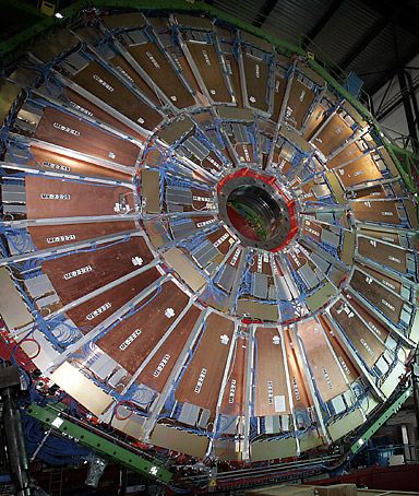 In a file picture taken on March 22, 2007 a woman walks close to the world's largest superconducting solenoid magnet (CMS), at the European Organization for Nuclear Research (CERN)'s Large Hadron Collider (LHC) particule accelerator.