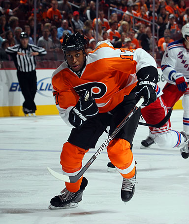 Wayne Simmonds of the Philadelphia Flyers skates against the New York Rangers during an NHL preseason game at Wells Fargo Center on September 26, 2011 in Philadelphia, Pennsylvania.
