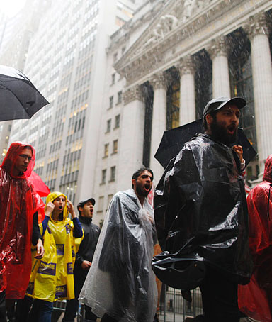 Protesters from the Occupy Wall Street campaign march in front of the New York Stock Exchange in New York September 29, 2011