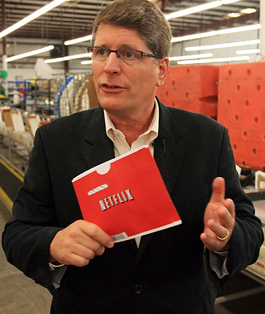 Steve Swasey, VP of Corporate Communications for Netflix, talks during an interview at the company's Orlando, Florida distribution center on August 11, 2009.