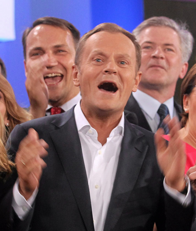 Poland's Prime Minister Donald Tusk, claps his hands after the election results announcement in Warsaw October 9, 2011