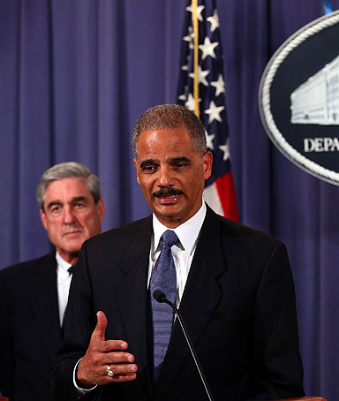 U.S. Attorney General Eric Holder, right, announces a plot was foiled involving men allegedly linked to the Iranian government to kill the Saudi ambassador to the U.S. in Washington at a news conference Oct.11, 2011, in Washington, DC