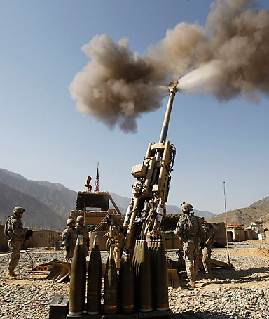 U.S. soldiers from Charlie Battery, 321st Field Artillery Regiment fire a artillery at a Taliban enemy position in Kunar province, eastern Afghanistan on September 28, 2011.