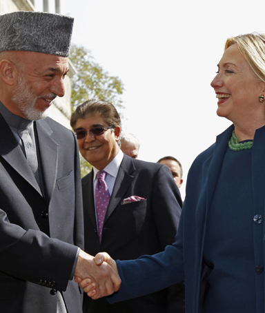 U.S. Secretary of State Hillary Clinton (R) meets Afghan President Hamid Karzai at the Presidential Palace in Kabul October 20, 2011