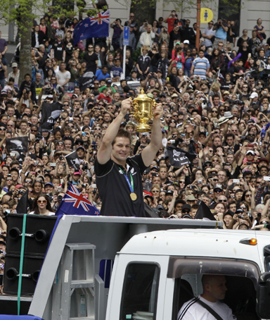 All Blacks captain Richie McCaw holds the Webb Ellis Cup aloft for supporters during a parade through Auckland's central business district to celebrate their Rugby World Cup victory in New Zealand, Monday, Oct. 24, 2011