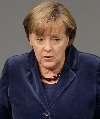 German Chancellor Angela Merkel gestures during her speech at the German federal parliament, Bundestag, in Berlin, Germany, Wednesday, Oct. 26, 2011.