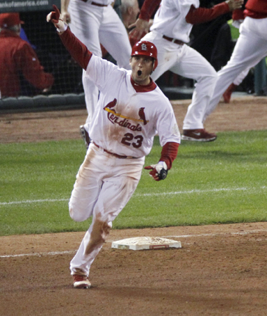 St. Louis Cardinals' David Freese reacts after hitting a solo home run off a pitch by Texas Rangers' Mark Lowe in the 11th inning of Game 6 of baseball's World Series Thursday, Oct. 27, 2011, in St. Louis