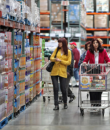 Shoppers browse items at a Costco Wholesale Corp. store in Chicago, Illinois, U.S., on Tuesday, Oct. 4, 2011.