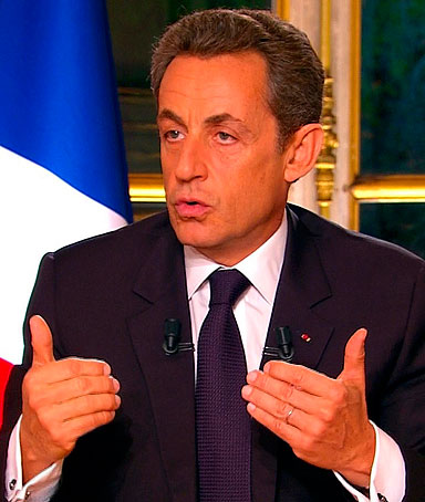 France's President Nicolas Sarkozy, seen in this video grab from TF1 French television in a prime time interview from the Elysee Palace in Paris, speaks to the nation about the eurozone economy the day after a summit in Brussels Oct. 27, 2011
