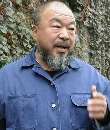 Chinese artist Ai Weiwei speaks to the media in front of his home in Beijing on Tuesday November 1, 2011.