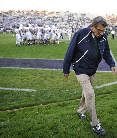 Penn State coach Joe Paterno walks off the field after warmups before Penn State's NCAA college football game against Northwestern on Saturday, Oct. 22, 2011, in Evanston, Ill.