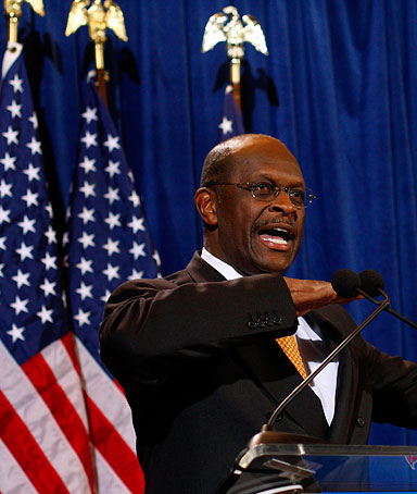 U.S. Republican presidential candidate Herman Cain speaks during a news conference in Scottsdale, Arizona November 8, 2011
