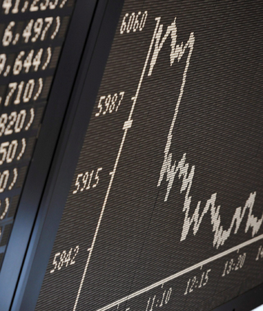 The DAX index curve shows considerable losses in the trading room of the stock exchange in Frankfurt/Main, Germany, 09 November 2011