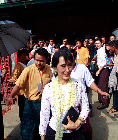 Burma democracy leader Aung San Suu Kyi leaves after the press conference at her National League for Democracy Party headquarters, Yangon, Burma, 14 November 2011