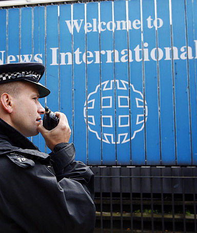 Police outside the offices of News International in Wapping, London on July 8, 2011.