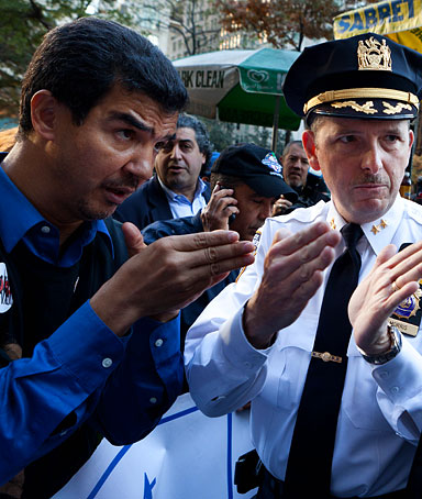 New York City Council Member Ydanis Rodriguez, left, speaks with Assistant Chief William Morris, center, and Captain Andrew Lombardo, right, on Nov. 7, 2011, in New York