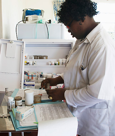 EAST LONDON, SOUTH AFRICA - SEPTEMBER 2008: A nurse prepares drugs for patients at the Keiskamma Trust treatment centre in the village of Hamburg.