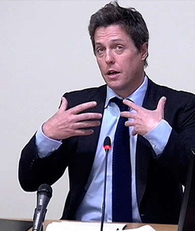 A still image from broadcast footage shows actor Hugh Grant speaking at the Leveson Inquiry at the High Court in central London November 21, 2011
