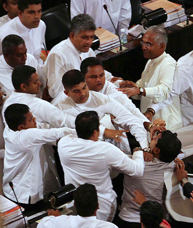 Sri Lanka's Members of Parliament of main opposition United National Party and government members of parliament clash as President Mahinda Rajapaksa presents the 2012 budget in Parliament in Colombo, November 21, 2011