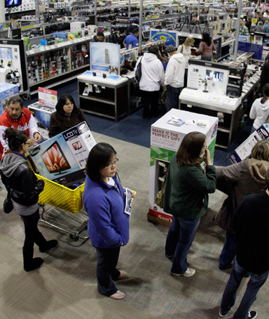 A checkout line winds through a Best Buy store as shoppers take advantage of a midnight Black Friday sale on Friday, Nov. 25, 2011, in Brentwood, Tenn. Black Friday began in earnest as stores opened their doors at midnight